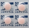 バイアグラのジェネリック薬のシルデナフィル錠50mgVI「テバ」の画像ですピンク色の円形の錠剤が4錠写ってます。